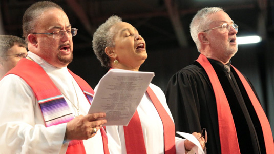 3 District Superintendents singing, Annual Conference 2014