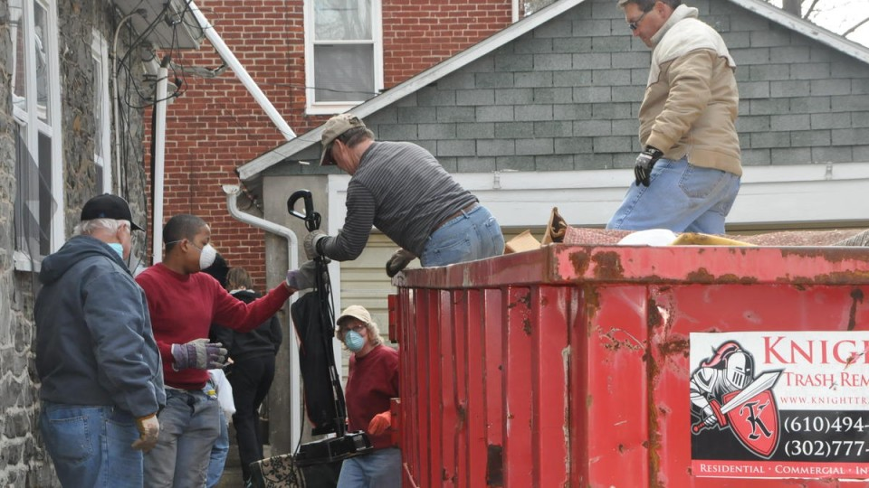Men cleaning out debris and damaged items