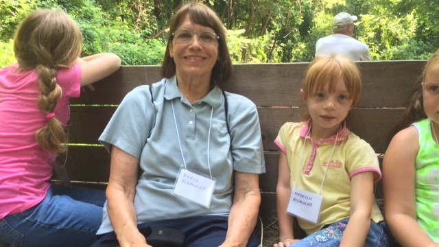 Doris Rismiller joins her granddaughter, Madelyn Rismiller, on a hayride at Camp Innabah's Grandparents & Me Camp.
