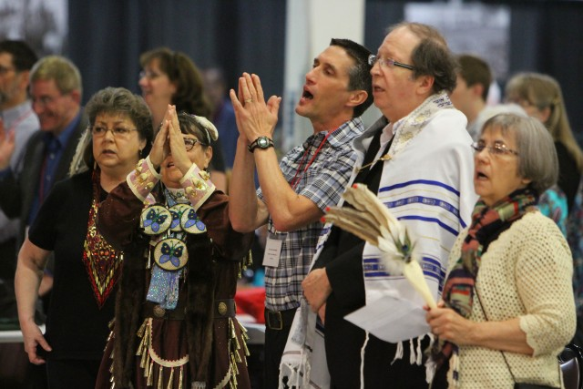 CONAM members, including the Rev. Gary Jacabella (center with hands raised), sing at Annual Conference 2015 during their presentation about children who attended, died and are buried at the former Carlisle Indian Industrial School. (Sabrina Daluisio photo)