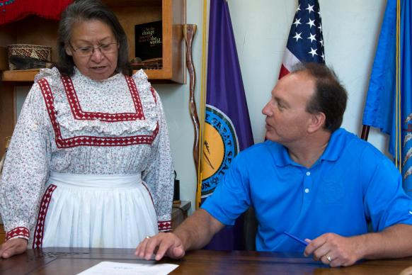 "Chief Gary Batton of the Choctaw Nation signs a proclamation declaring the second Monday of October as ""Indigenous Peoples' Day."" Witnessing the signing is the Rev. Billie Nowabbi, a retired pastor in the Oklahoma Indian Missionary Conference."