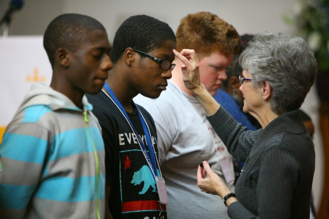 """""""YES"""" Call to Ministry Youth Retreat, 2014, Bishop Peggy Johnson annointing young man"""