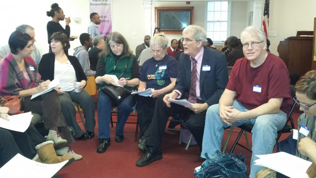 The Rev. Jeffrey Tatgenhorst (2nd from right) leads a group of UMs in selecting issues to focus on for POWER Metro's advocacy efforts.