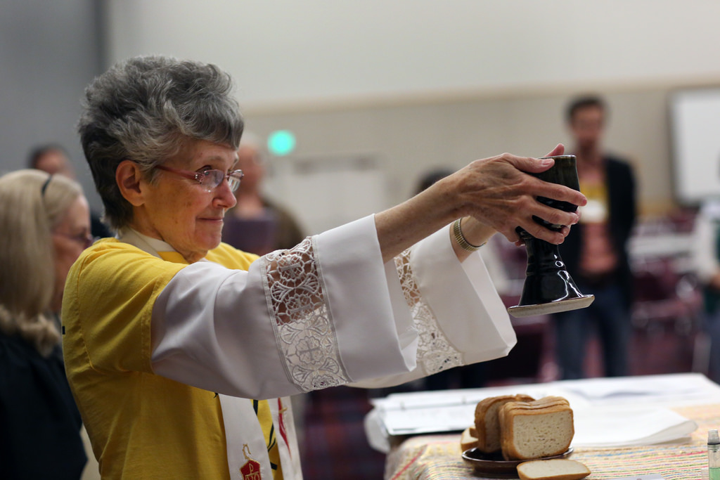 Bishop Peggy Johnson serving mid-day Communion
