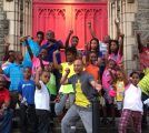 """Pictured at Wharton-Wesley United Methodist Church are Senior Pastor Rev. Eric W. Carr, Jr., (far left front row in red shirt) and the Rev. David W. Brown, Deacon (center in gray """"Batman"""" shirt) as they strike a superhero pose with neighborhood children with whom they work in their community ministry there."""